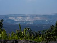 Kīlauea Volcano's most recent summit collapse occurred at 8:00 a.m. HST today (July 31). South Sulphur Bank, a cliff of altered, light-colored rock now more than 80 m (260 ft) high, is visible on the far caldera wall. Another area of altered rock that's being exposed as part of the caldera floor drops is visible near the center of this image. Photo taken Tuesday, July 31, 2018 courtesy of U.S. Geological Survey