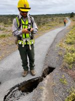 A sinkhole is checked on Crater Rim Trail at Hawaii Volcanoes National Park. NPS Photo