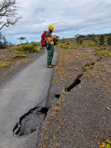 Fractures and sinkholes on Crater Rim Trail are assessed for damage at Hawaii Volcanoes National Park. NPS Photo.