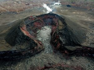 This UAS oblique image of fissure 8 shows that the new lava is mostly confined to the crater floor within the cone, although a small amount extended a short distance into the spillway. By early evening, HVO geologists noted that the lava activity was at a low level, with only minimal (if any) incandescence emanating from the cone. Gas emissions from the vent were nearly nonexistent. Photo taken Sunday, September 2, 2018 courtesy of U.S. Geological Survey