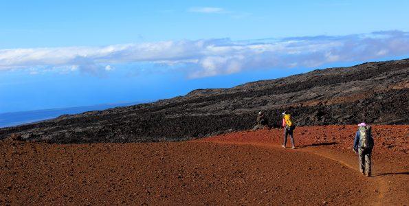 Hikers descending Mauna Loa Trail from Pu'u 'Ula'ula. NPS Photo/Jessica Ferracane