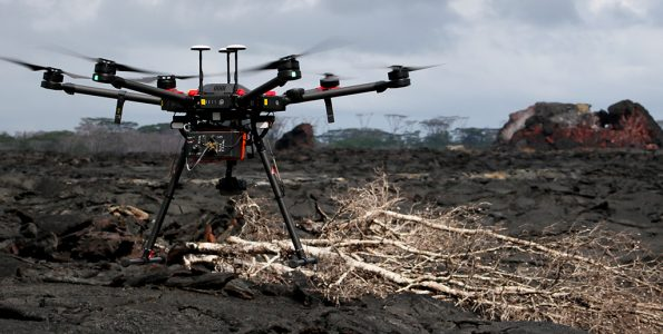 A close-up of the Unmanned Aircraft System (UAS) used by USGS scientists to measure volcanic gases in remote areas of Kīlauea. The fissure 21 cone is visible in the far right background. Photo taken Monday, November 26, 2018 courtesy of U.S. Geological Survey