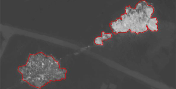 Bright red polygon features were drawn by USGS Geographic Information Systems (GIS) analysts around new or active lower East Rift Zone lava flows, which appear lighter in color due to their high temperature on this thermal map. Collected during a helicopter overflight on May 9, 2018, this map shows fissures 6 (left) and 15 (right) with Pohoiki Road passing between the two vents. USGS map.