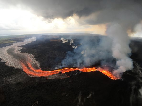 During the first two weeks of Kīlauea Volcano's 2018 lower East Rift Zone eruption, fissures were characterized by low eruption rates and small flows. This was because the erupted lava originated from pockets of cooler, less fluid magma stored in the rift zone. Later fissures erupted hotter, more fluid magma, resulting in higher eruption rates and large, fast-moving lava flows, like that erupted from the fissure 8 cone (lower right), shown here on July 29, 2018.USGS photo by M. Patrick.