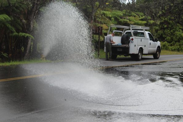 Flushing a waterline near Kilauea Visitor's Center. NPS Photo